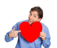 Man pointing at a large heart Stock Image