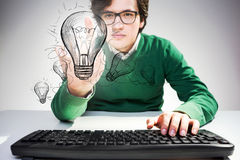 Man pointing at lighbulb Royalty Free Stock Photography