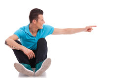Man pointing and looking to side Royalty Free Stock Photos