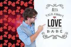 Man pointing at love message against digitally generated heart background Stock Photo