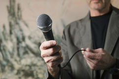 Man pointing microphone Stock Image