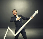 Man pointing over dark Royalty Free Stock Images