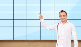 Man pointing at plasma wall Stock Image