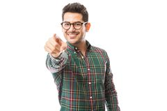 Man Pointing For Recruitment Over White Background. Young man in checkered shirt pointing for recruitment over white background royalty free stock images