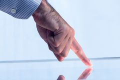 Man pointing on reflective surface Royalty Free Stock Image