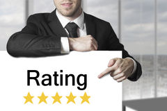 Man pointing on sign rating stars Royalty Free Stock Photography
