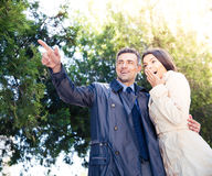 Man pointing on something with happy woman Stock Photo