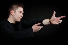 Man pointing at something interesting Stock Photos