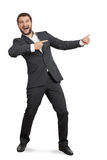 Man pointing at something and screaming. Laughing young businessman in suit pointing at something and screaming. isolated on white background Stock Image