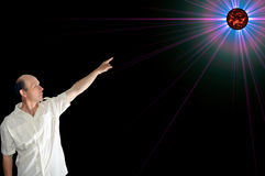 Man pointing at space object. Man in white shirt pointing at space object Royalty Free Stock Photography