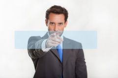 Man pointing in studio isolated Stock Photography