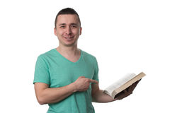 Man Pointing To Book Isolated On White Background Stock Photo