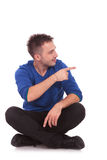 Man pointing to his left side Royalty Free Stock Image