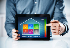 Man pointing to an interface for a smart house Royalty Free Stock Photo