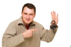 Man pointing to open lock Stock Image