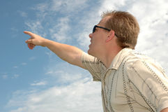 Man Pointing to the Sky. Man with sunglasses points up to the sky Stock Photography
