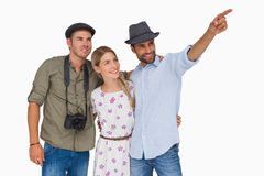 Man pointing to something with friends and one has camera Royalty Free Stock Photography