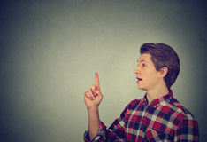 Man pointing up has idea Stock Images