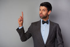Man pointing up and looking at camera Stock Photography