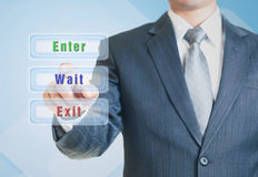 Man pointing the wait option Royalty Free Stock Photo