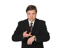 Man pointing at watch. Isolated on white background royalty free stock photography