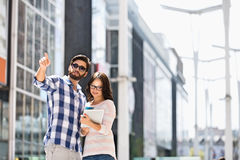 Man pointing while woman using digital tablet outside building Royalty Free Stock Photos
