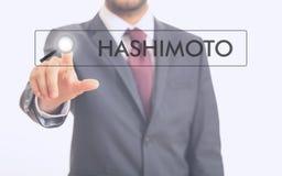 Man pointing at word Hashimoto Royalty Free Stock Photo