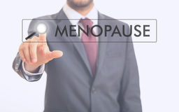 Man pointing at word menopause Royalty Free Stock Images