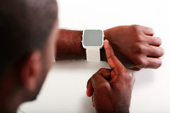 Man pointing on wristwatch Stock Image