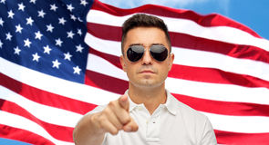 Man pointing on you over american flag background Royalty Free Stock Image