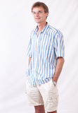 The man in points. Portrait of the successful man in a striped shirt stock image