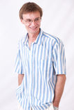 The man in points. Portrait of the successful man in a striped shirt royalty free stock photography