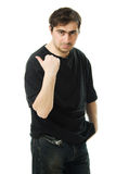 Man points a finger behind his back. Stock Photos