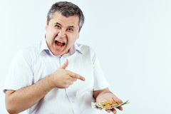 Man points a finger at Bitcoins. royalty free stock images