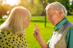 Man points finger at woman. Stock Image