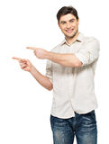Man points with fingers in the right side Stock Image