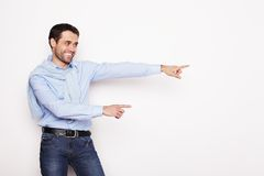 man points with fingers in the right side Stock Photography