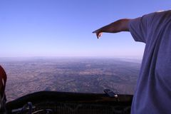 Man Points Towards the Horizon in Hot Air Balloon Stock Photos