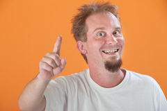 Man Points Up. Happy Caucasian man points index finger upward Royalty Free Stock Photos