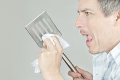Man Polishes BBQ Spatula Stock Images
