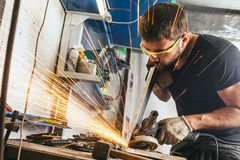 Man polishes the metal angle grinder stock photo