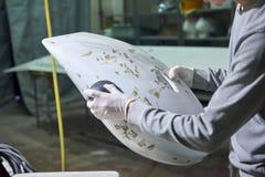 Man is polishing airplane part. royalty free stock image