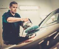 Man polishing car with a polish machine Royalty Free Stock Photo