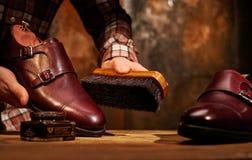 Man polishing leather shoes with brush. Stock Images