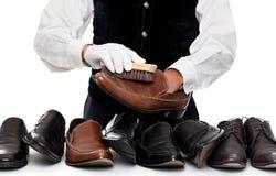 Man polishing leather shoes Stock Photos