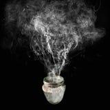 Man polluting environment. Contaminated smoke coming out of a jar Stock Photos