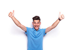 Man in polo shirt showing thumbs up sign Stock Photo