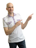 Man in polo t-shirt pointing to copy space Stock Images