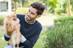 Man with Pomeranian spitz Stock Images