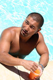 Man at the Pool. Asian Man enjoying a drink at the pool Stock Image